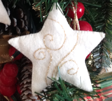 Sparkling embroidered felt star - gold